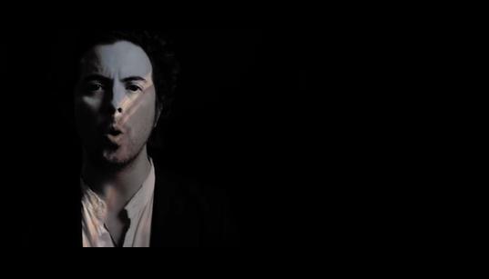 image of man singing