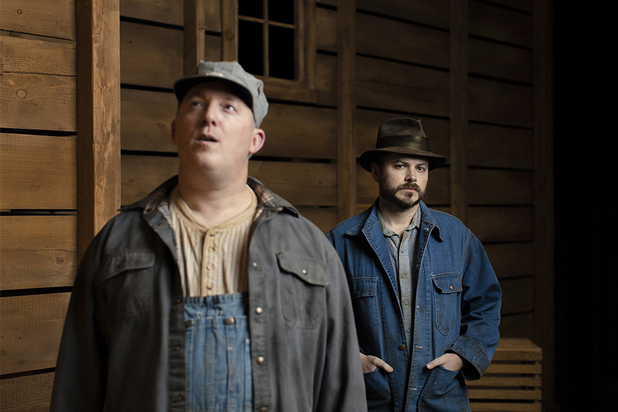 two men standing in a barn